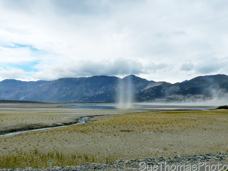 Looking west with weird dust rising on the mud flats of Slims River, Kluane Lake
