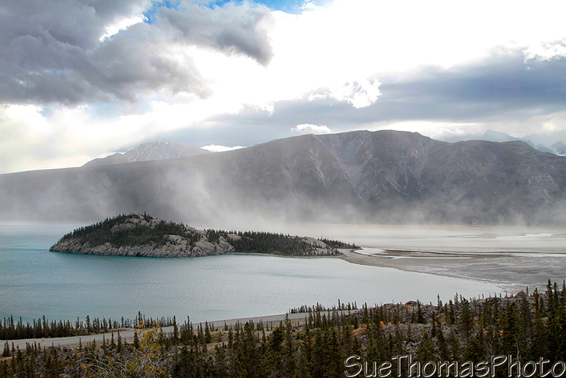 The island in Kluane Lake with a dust storm