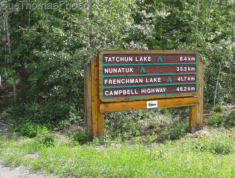 Sign at Tatchun Lake road and Klondike Highway, Yukon