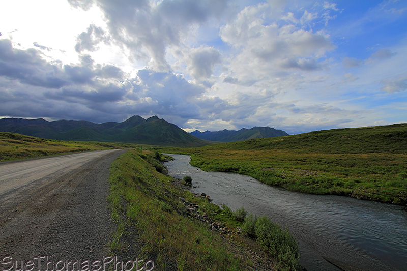 Dempster Highway in Yukon and a river beside it