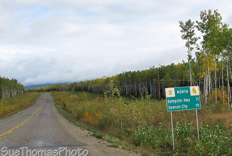 Distance sign to Dawson City
